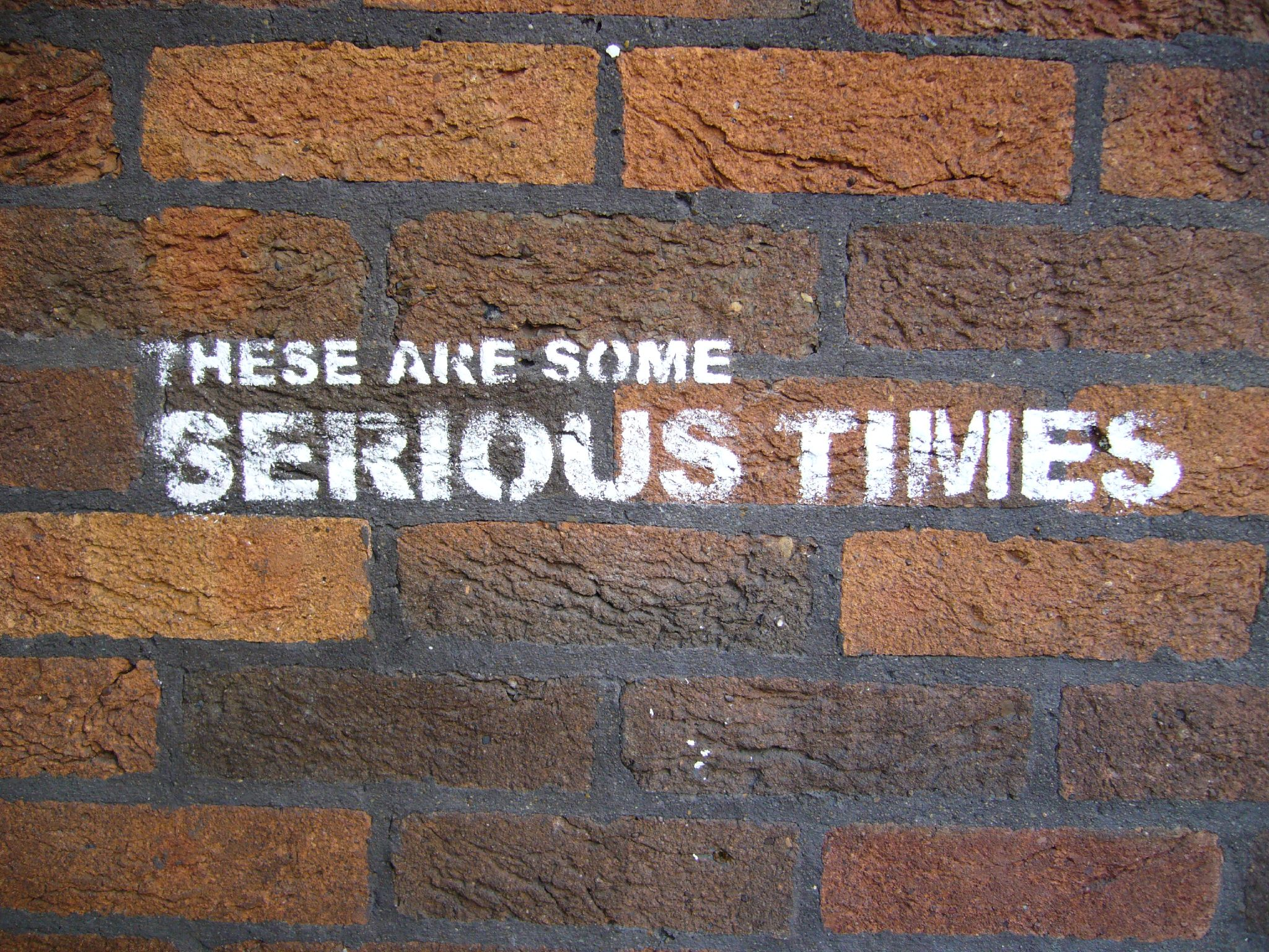 Graffiti on wall: These are some serious times